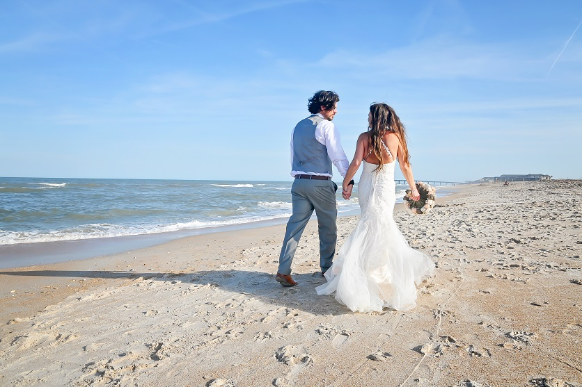 Barefoot wedding couple on St. Augustine Beach