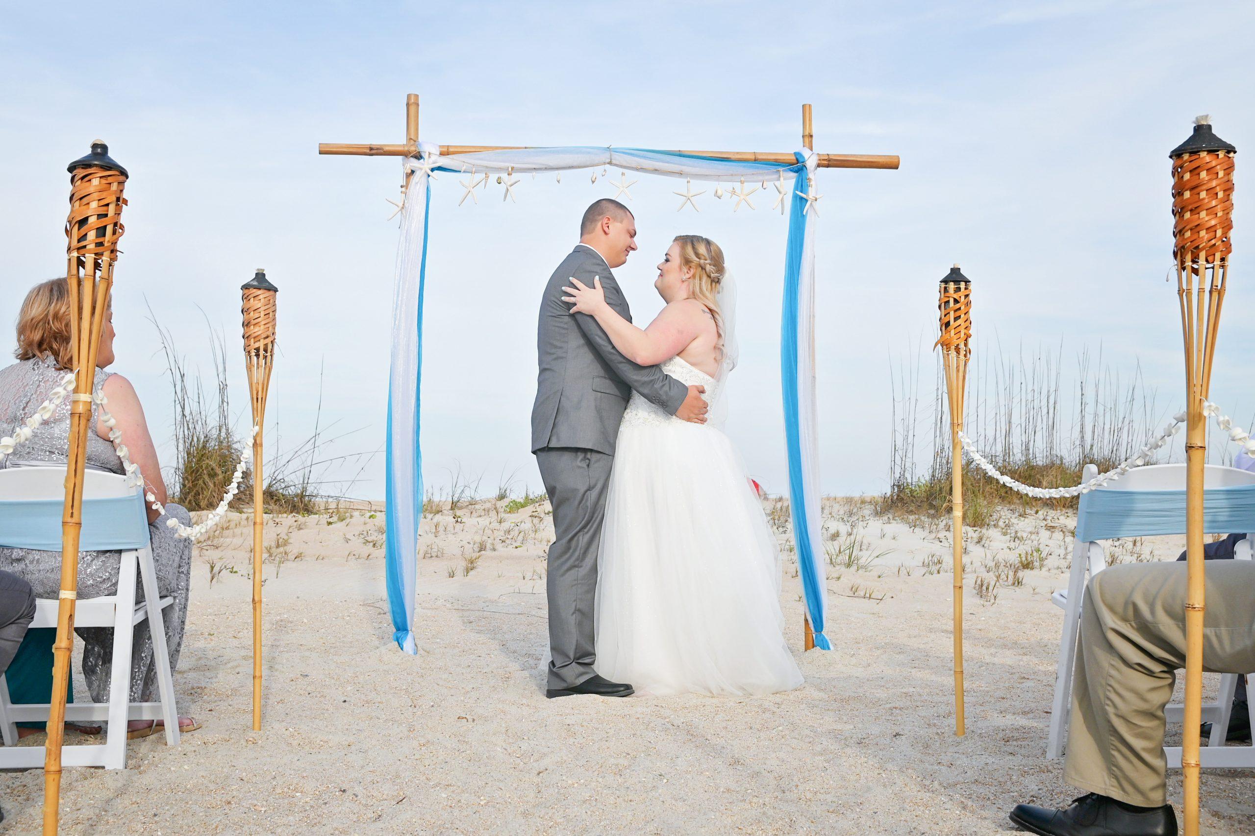 St Augustine Wedding couple says vows under arch on beach