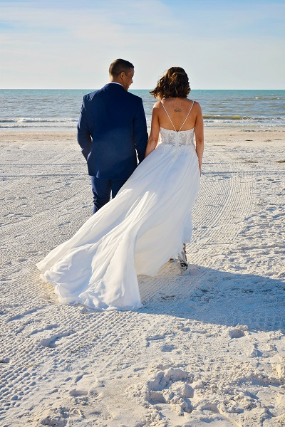 Beach Wedding dress back view spaghetti straps with groom on Clearwater Beach