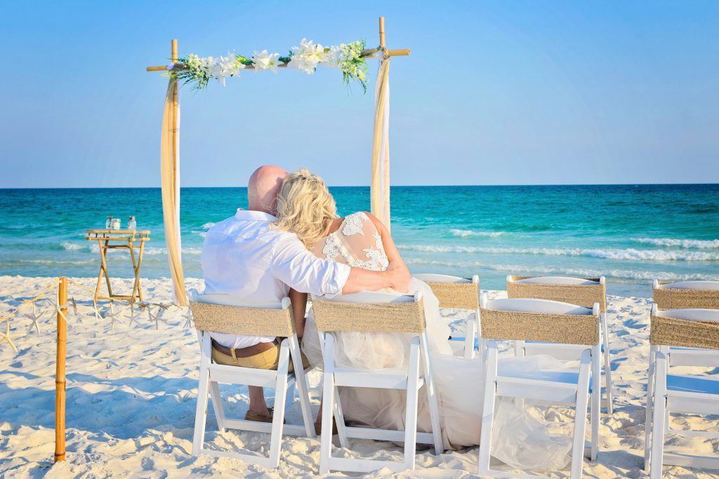 Wedding couple sits by the beach in Clearwater
