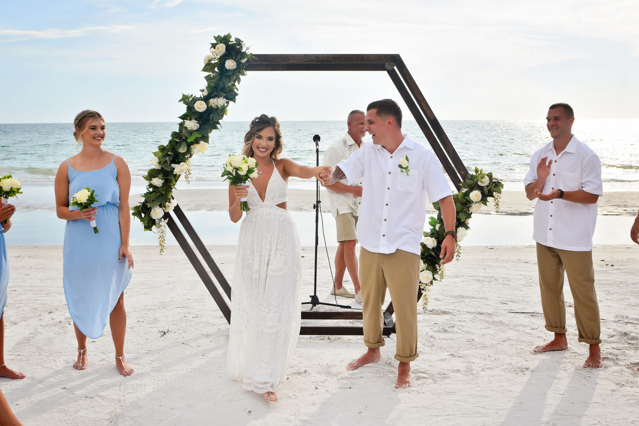 geometric rustic wooden wedding arch on the beach